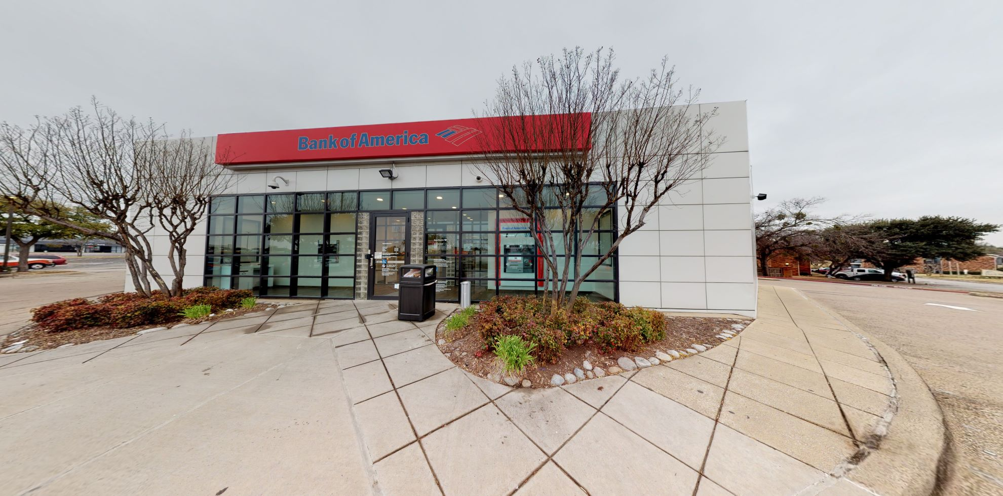 Bank of America financial center with drive-thru ATM | 3028 N Josey Ln, Carrollton, TX 75007