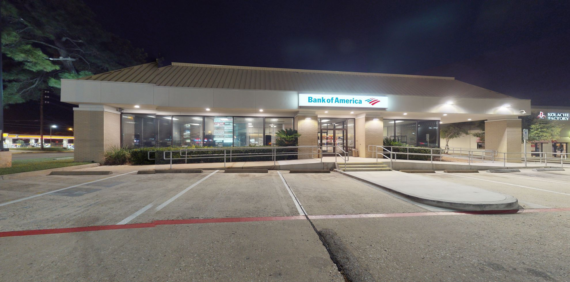 Bank of America financial center with drive-thru ATM   125 Sawdust Rd, Spring, TX 77380
